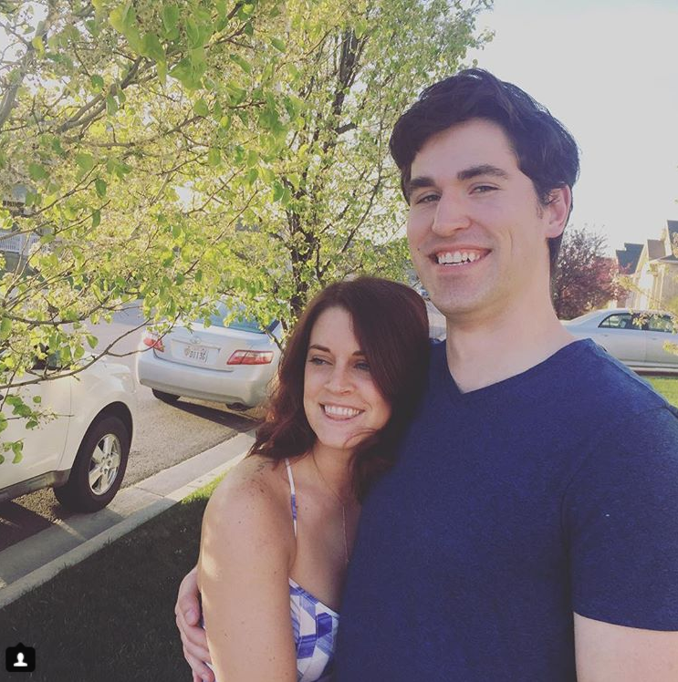 An Instagram picture of Ellie and her husband on a Spring day.