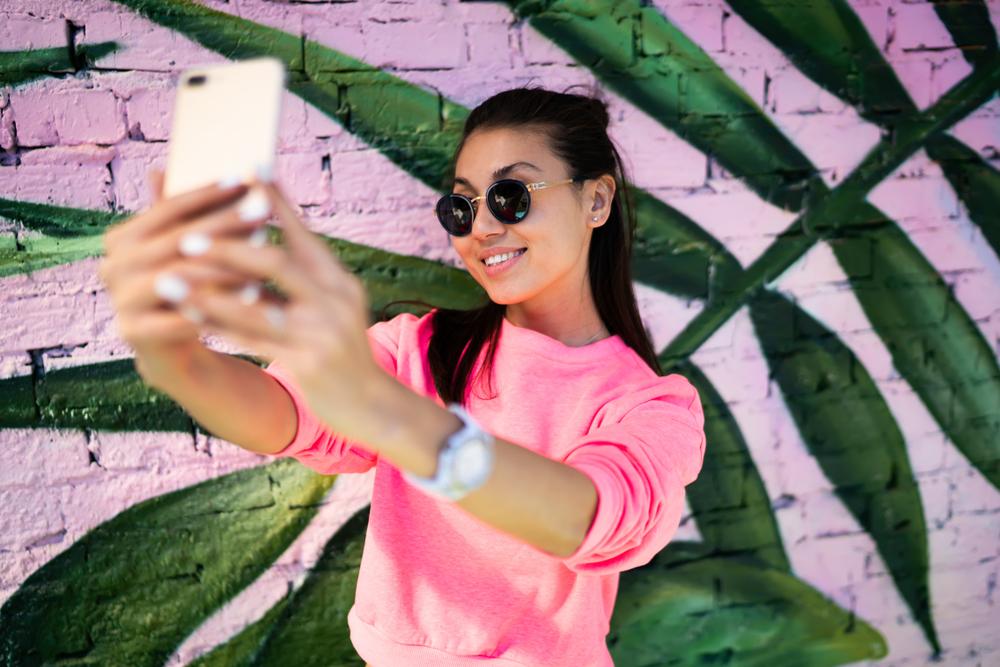 a woman taking a selfie